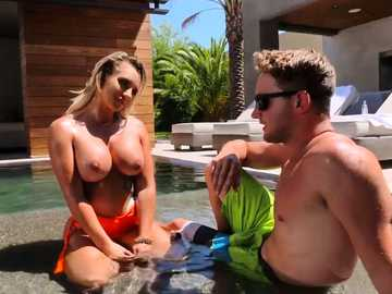 Crummy blonde Cali Carter gets her tits wet while she has fun over the pool